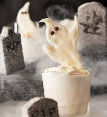 White chocolate or almond bark can make ghastly garnishes.  Spread melted chocolate or almond bark onto wax paper, shape and let cool. Mini chocolate chips, pushed in tip down while semi-warm, or icing in a tube, adds your facial features.