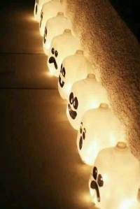 Upcycle those milk and juice jugs with a battery operated tea light candle and a sharpie.