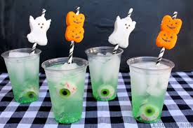 Even kiddos can enjoy these ghastly drink stirrers. Easy to make with a skewer (metal, plastic, wood, your call)  and some marshmallow peeps!