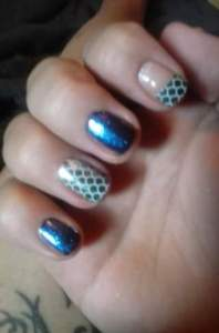 Mermaids Tales, one of the top sellers. I use one wrap and get a ring finger accent on both nails, plus the French tip!